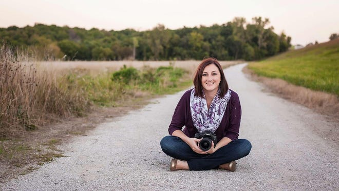 Shown in a self-portrait, Lacey Whitmer moved her photography business (and her family) from Kansas City to Ozark in 2015.