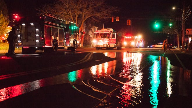 Fire crews respond to a house fire, late Saturday night, on Main Street in Winooski.