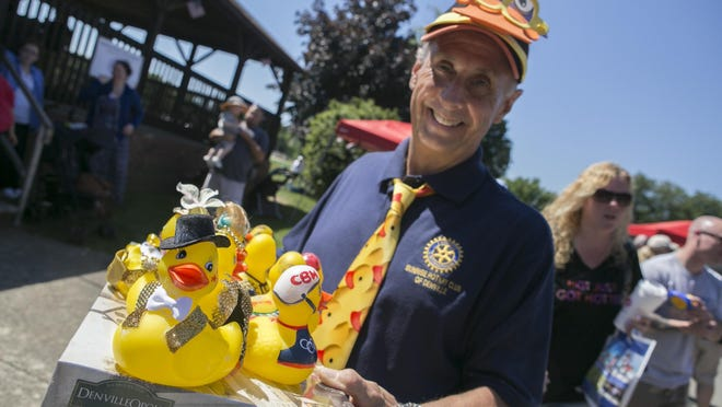 Sunrise Rotary member Roger Riedel holds some of the ducks designed and decorated by his family.
