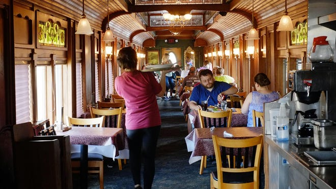 The restored railcar at Clara's Restaurant in Lansing is a popular choice among customers. Photo: Monday, June 20, 2016.