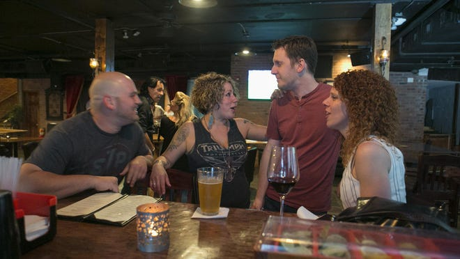 Patrons Matt Serillo and Gabrielle DePinto-D'Aquanni of Morristown talk with Wes and Christy Cronkite of Rockaway early on a Thursday evening. Laundromat Speakeasy in Morristown.