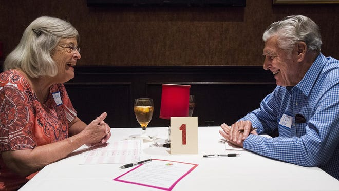 Joanne Hale, 76, and Ted Eckhardt, 83, share a five-minute date at a senior speed dating event at Bob's Steak & Chop House in San Antonio.