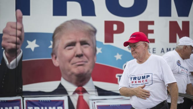 Tony Ledbetter, right, of Daytona Beach, Fla., sets up a pro-Trump mobile voter registration station before the Republican presidential candidate spoke Wednesday at a campaign rally at the Entertainment Hall at the Florida State Fairgrounds in Tampa.