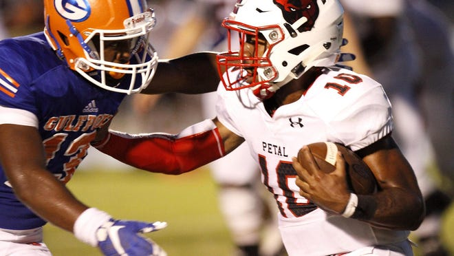 Petal quarterback Tanner Estill carries the ball against Gulfport during their game Friday night.