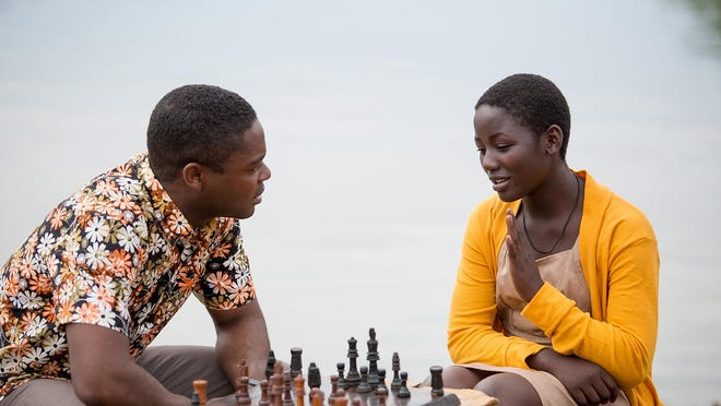 """Madina Nalwanga, right, and David Oyelowo appear in a scene from """"Queen of Katwe."""""""