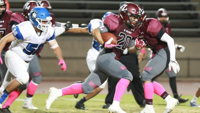 Mt Whitney's Jason Rosas (20) rushes for long gain against Hanford West in a West Yosemite League High School Football game at Mineral King Bowl.