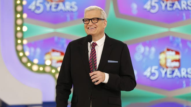 "In this image released by CBS, host Drew Carey appears on the set of ""The Price is Right."" On the episode airing Monday, Oct. 17, 2016, a trio of contestants spun $1 on the game show's famous wheel. The three contestants each landed on different combinations of $1 in a pair of spins during one of the show's showcase showdowns. Carey pumped his fist in the air after the contestants achieved the first three-way tie in the show's history. (Monty Brinton/CBS via AP) ORG XMIT: NYET121"