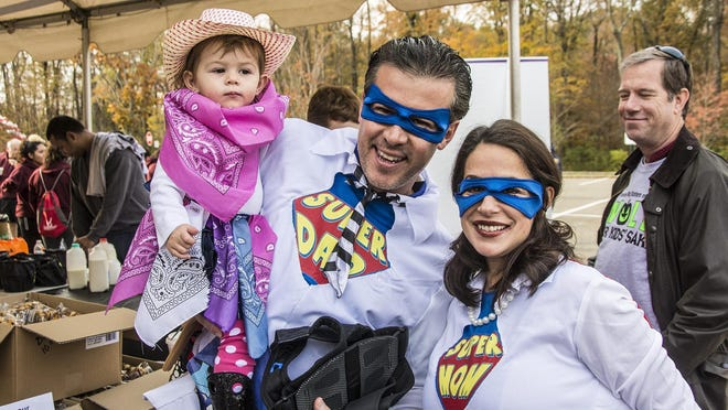 (L-R) Superheroes 16 month old Camila Marvaez of Morristown, dad Miguela nd mom Tanya at the 10th Annual Walk For Kids Sake by Big Brothers Big Sisters of Northern New Jersey at Wyndham Worldwide Headquarters in Parsippany, October 30, 2016. .