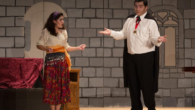 "Sophie Miller (Gypsy) and Eric Davis (Dracula) rehearse ""Dracula the Twilight Years"" at Tulare Union High School."