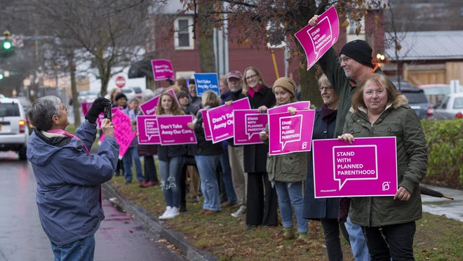 Employees and supporters rally to support Planned Parenthood of the Southern Finger Lakes in December 2015 in Ithaca.