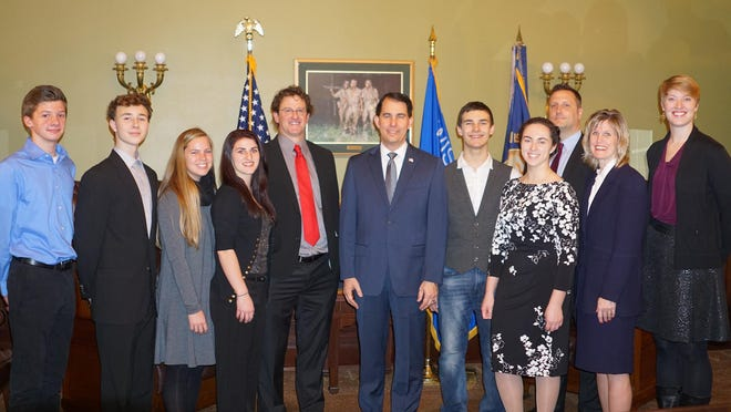 A group of Neenah high school students and staff members were recognized by Wisconsin Gov. Scott Walker during his annual State of the State address on Jan. 10. Pictured are, from left, Ethan Weyenberg, Carson Tuchscherer, Ally Keach, Brianna Kuske, teacher Gregg Goers, Gov. Walker, Darian Frawley, Caroline Vitale, high school principal Brian Wunderlich, superintendent Dr. Mary Pfeiffer and teacher Emily Bennett.