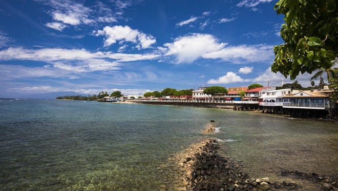 A waterfront view shows Front Street in Lahaina, Maui, Hawaii. Front Street is Lahaina's main downtown street, home to small businesses and opportunities for sightseeing and people-watching.