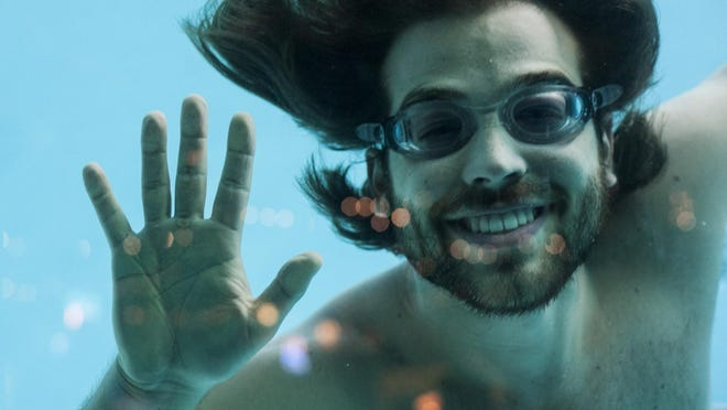 "Darien ""Adonis"" Gostas swims as a merman at the Sip 'n Dip Lounge. The Sip 'n Dip has two mermen but is trying to recruit Channing Tatum for a swim."