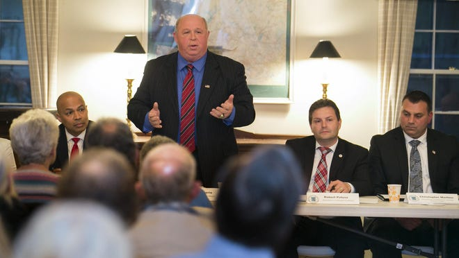 Incumbent mayor James Barberio speaks during the event. At left is Democratic mayoral candidate Michael Soriano; at right is Republican mayoral candidate Robert Puluso and council candidate Christopher Martino. Parsippany mayoral and council candidates, both Democrats and Republicans, discuss their qualifications and platforms as well as take questions from the audience at the Puddingstone Community Club, Parsippany, Tuesday, May 23, 2017. Special to NJ Press Media/Karen Mancinelli/Correspondent Parsippany Candidates Night