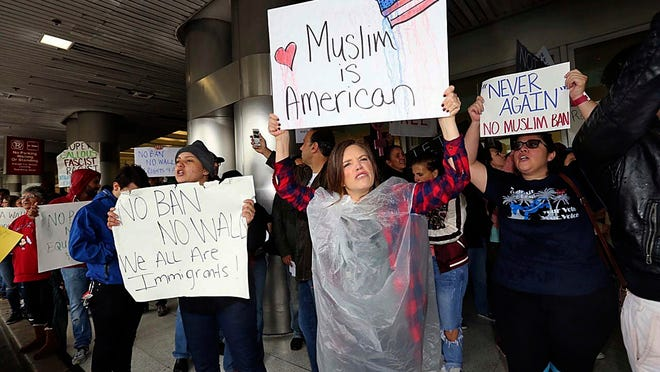 Protesters rally against President Trump's refugee ban at Miami International Airport on Sunday, Jan. 29, 2017. President Trump''s immigration order sowed confusion and outrage across the country, with travelers detained at airports, panicked families searching for relatives and protesters registering their opposition to the sweeping measure.