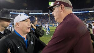 Kentucky coach Mark Stoops, left, meets Mississippi State coach Joe Moorhead at midfield after an NCAA college football game in Lexington, Ky., Saturday, Sept. 22, 2018. (AP Photo/Bryan Woolston)