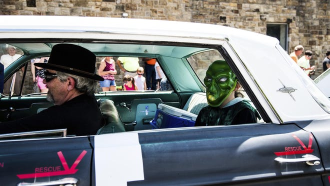 """Parade participants make their way through Kecksburg, Pa., during the UFO parade on Saturday, July 27, 2019 at the Kecksburg UFO Festival. While the Kecksburg UFO sighting has become a quaint part of local lore, more recent reports of unexplained aerial phenomena are getting serious attention from Congress, the U.S. military and longtime UFO watchers. """"It's not going away,"""" said retired journalist Bob Gatty. Meanwhile, longtime local UFO researcher Stan Gordon reports a """"surge"""" in sightings of unexplained phenomena in western Pennsylvania. (Shane Dunlap/Pittsburgh Tribune-Review via AP)"""