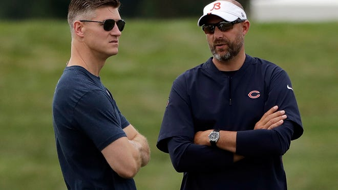 Chicago Bears coach Matt Nagy, right, talks with general manager Ryan Pace during NFL football training camp in Bourbonnais.