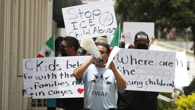 Protestors rally through the streets of DeLand to protest immigration and treatment of children detained, Sunday, June 28, 2020.