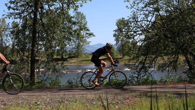 Cyclists are a given along Middle Fork Path in Springfield.