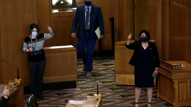 Rep. Tiffiny Mitchell, D-Astoria, (left) and Rep. Teresa Alonso Leon, D-Woodburn, vote in the House of Representatives during a special session of the Oregon Legislature in the Oregon State Capitol on Thursday.