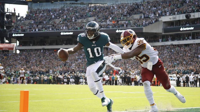 Philadelphia's DeSean Jackson (10) catches a touchdown pass against Washington's Montae Nicholson during the second half of a Sept. 8 game in Philadelphia.