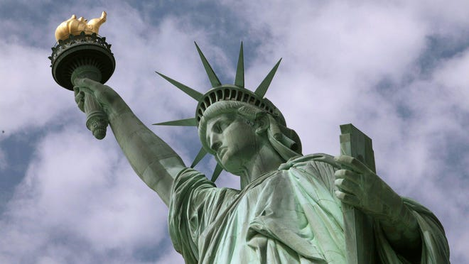 The Statue of Liberty stands in New York harbor, June 2, 2009.