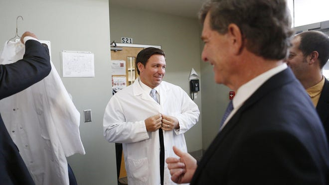 Florida Gov. Ron DeSantis this week put on a lab coat before touring  where potential coronavirus cases will undergo testing at the Florida Department of Health Laboratory in Tampa.