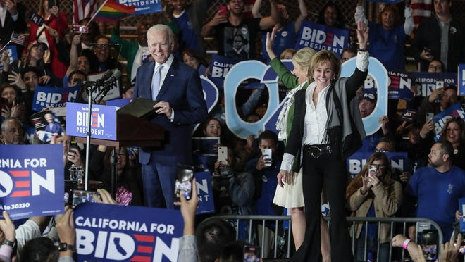 Democratic Presidential hopeful Joe Biden takes the stage with his wife, Jill, and sister, Valerie, right, during a campaign rally at the Baldwin Hills Recreation Center in Los Angeles on Tuesday, March 3, 2020.