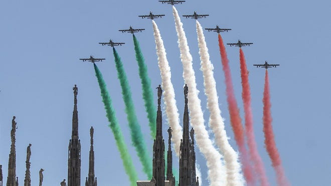 The Frecce Tricolori aerobatic squad of the Italian Air Force flies over Milan's Duomo cathedral, northern Italy, Monday, May 25, 2020 on the occasion of the 74th anniversary of the founding of the Italian Republic on June 2, 1946. This year the acrobatic squad will fly over several Italian cities to bring a message of unity and solidarity during the coronavirus pandemic.