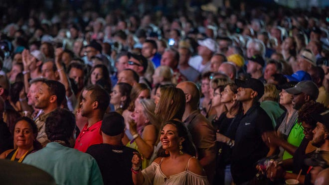 Concertgoers flocked by the thousands to downtown West Palm Beach on Friday night concerts for SunFest 2019 in May 2019.