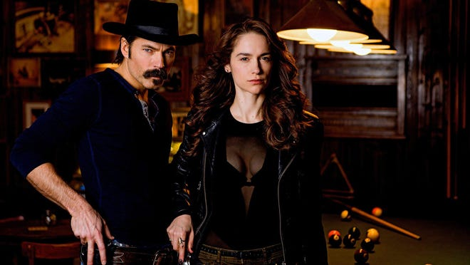 "Tim Rozon as Doc Holliday and Melanie Scrofano as the title character in ""Wynonna Earp"""