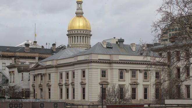 Photo of the New Jersey Statehouse. The capitol dome and the back of the statehouse.