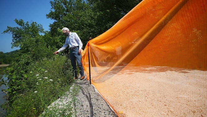 U.S. Sen. Rob Portman takes a look at a site in need of repair along the Ohio & Erie Canal Towpath Trail during a tour Wednesday of the Cuyahoga Valley National Park.