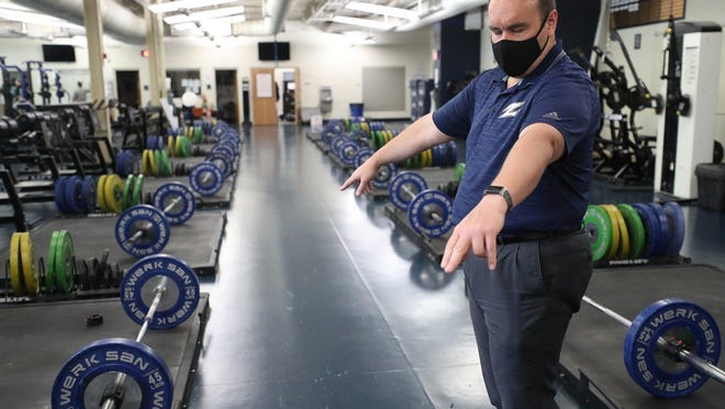 Bill Droddy, University of Akron director of sports medicine, explains Thursday, July 2, 2020, how lift stations are distanced more than 6 feet apart in the Stile Athletics Field House. Equipment will be wiped down by staff and fogged between workout sessions, he said.