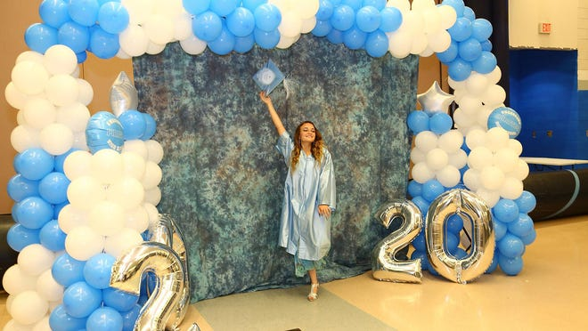 Jade Ingram tips her mortarboard as graduates of Swansboro High School accompanied by family and friends received their diplomas then gathered for a few moments to take some special photos.