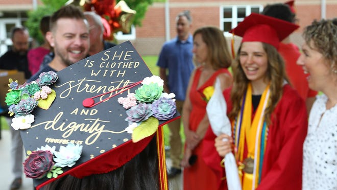 The decorated cap worn by Lejeune High School graduate Abigail Paquin shares an inspirational message. She stands with valedictorian Sophia Marie Harding as graduating seniors received their diplomas as they walked across the stage to the cheers of family and friends.