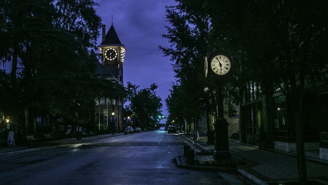 An early dawn view of the Baxter Clock. City Hall is in the background.