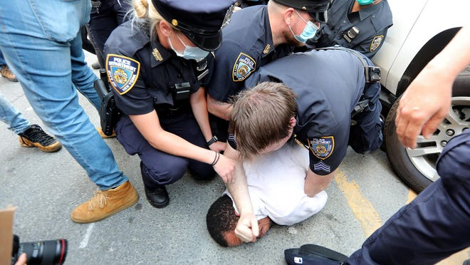 Police arrest a protestor May 29 as hundreds of people gathered in lower Manhattan to protest the death of George Floyd in Minneapolis.
