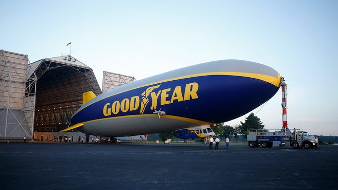 The newest Goodyear blimp, Wingfoot Three, is moved out of the hangar for testing at the Goodyear blimp base on Thursday, June 21, 2018, in Suffield Township, Ohio.