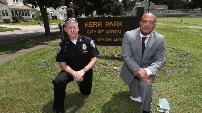 Akron Police Capt. Agostino Micozzi worked with community organizer E.J. Brinson on community policing around the Kerr Park area near Copley Road in Akron.