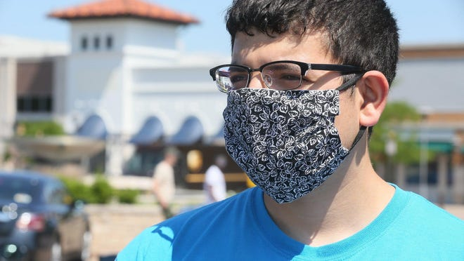 Jalal Jwayyed, 21, of Copley talks about wearing a mask on Tuesday June 30, 2020, in Fairlawn. The city of Akron is considering a measure that would make masks mandatory in public for most people.
