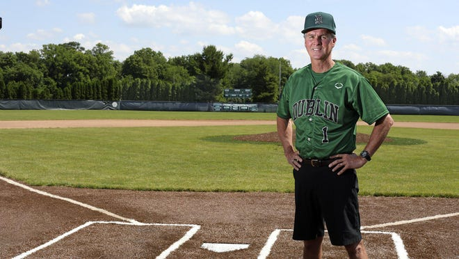 "Retiring Dublin Coffman baseball coach Tim Saunders, the 2020 winner of the Lou Berliner Memorial Award for longtime service to high school sports in the area, stands at Deck Webb Field. Saunders arrived at the school in 1988, when the field ""was full of weeds."""