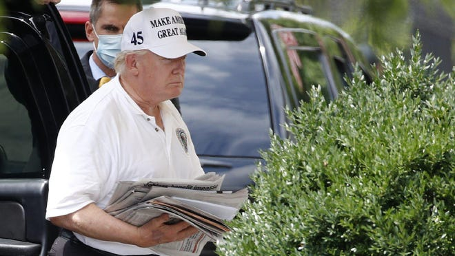 President Donald Trump arrives at the White House in Washington, Saturday, Aug. 1, 2020, as he returns from a visit to Trump National Golf Club in Sterling, Va.