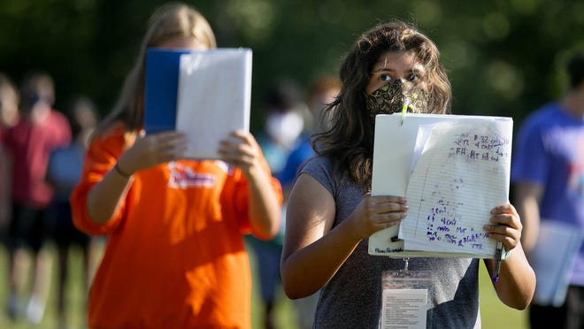 Diana Huarach-Arellanos, a junior who plays the euphonium in the Olentangy Orange High School marching band, pays close attention Wednesday to drills that promote social distancing.
