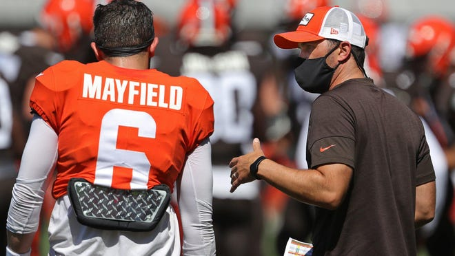 Browns coach Kevin Stefanski, right, speaks with quarterback Baker Mayfield  during practice Aug. 19.