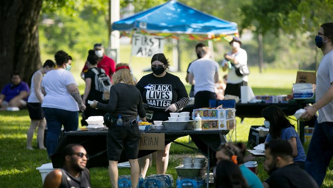 """Several hundred people gathered at Goodale park, for the """"Light and Love BBQ"""" Juneteenth celebration, Friday, June 19, 2020. The event was entirely community organized and funded in under 10 days, with over $3500 collected to feed up to 600 people."""