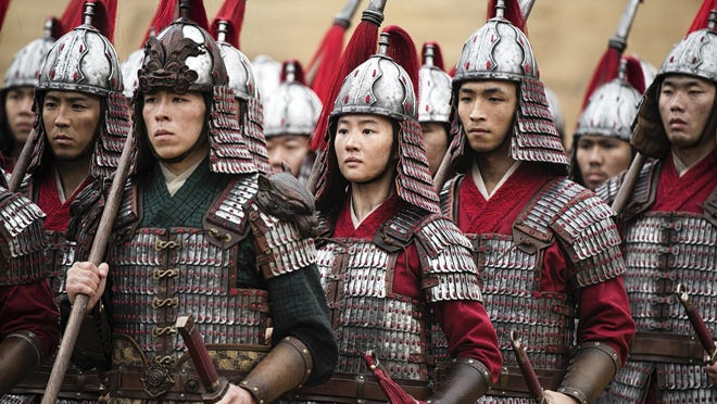 Mulan (Yifei Liu, center) does her best to mix in with the guys.