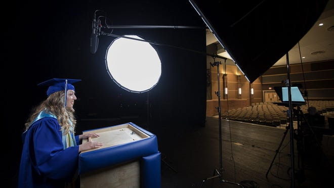 "Madison Voinovich, Olentangy Berlin High School's first valedictorian, records her speech to her graduating class in an empty school auditorium on Tuesday. ""We have taken our vow to be 'historic' to levels we couldn't have even imagined,"" she joked -- including the most successful streak of ""senior skip days"" ever."