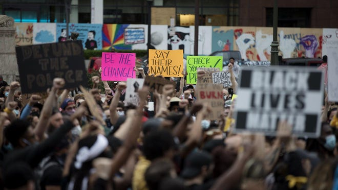 Protestors march around the Statehouse in Downtown Columbus on June 4, in response to the May 25th death of George Floyd while pinned to the ground by a Minneapolis police officer.